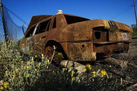Rusted car instead of shipping container